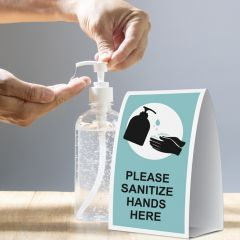 Hand sanitizer sign on a table tent